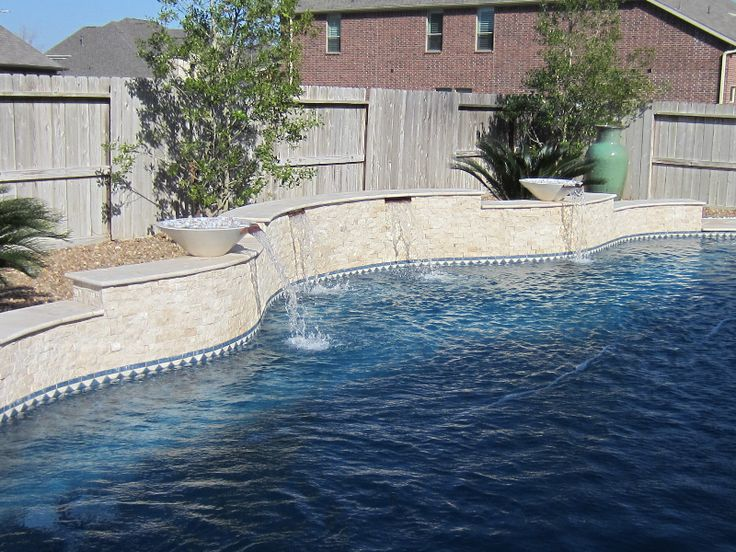 Split face travertine with pool waterline tile pool water features pinterest travertine for Best thinset for swimming pool tile