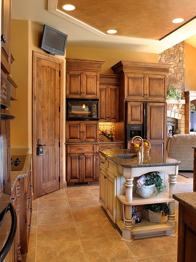 Love the cabinet color.  This looks like stain over stain.  The wall color is gorgeous and warm.  Love the floors here too.