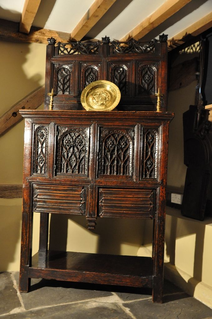 A MAGNIFICENT AND RARE HIGH STATUS 15TH CENTURY WALNUT BUFFET / DRESSOIR.-THIS OUTSTANDING LATE MEDIEVAL WALNUT BUFFET IS OF THE HIGHEST QUALITY, THE TOP WITH PIERCED GOTHIC TRACERY FLANKED BY GOTHIC FINIALS, ABOVE FOUR DEEPLY CARVED TRACERY PANELS.