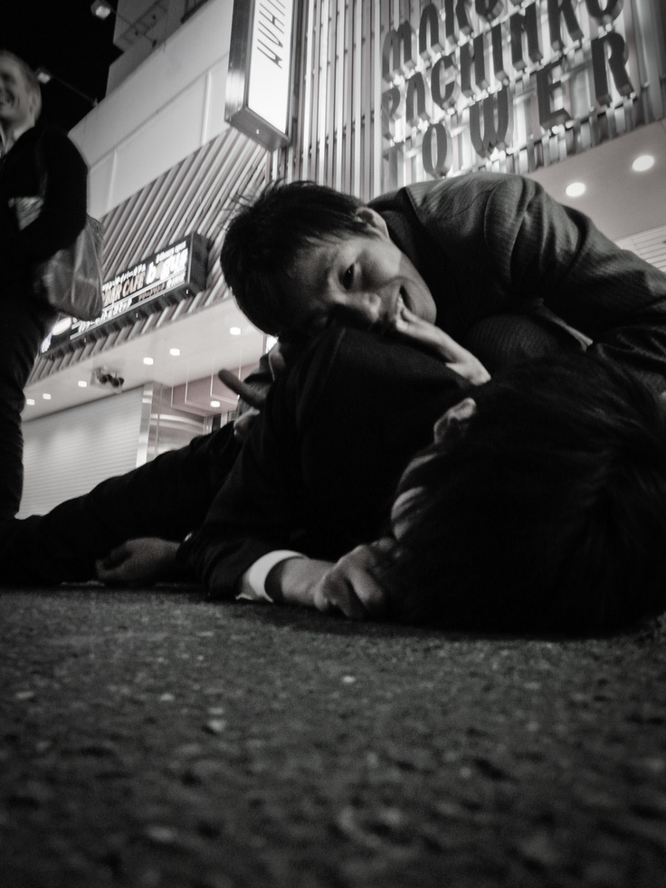 i took this picture of a salary man passed out drunk on the street of #shibuya #tokyo standard business....
