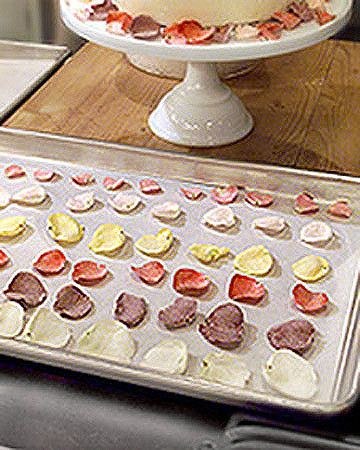 Q. What is the best way to crystallize rose petals for a wedding cake?--Liza Deras, Rancho Cucamonga, CaliforniaCrystallized edible rose petals make a beautiful garnish for a wedding cake, and the process is very simple. It's important that you always use organically grown roses; those that have been sprayed with pesticides (as most roses at florists' shops have been) should never be eaten.The best way to crystallize rose petals is to work with the individual petals. When you try to s...