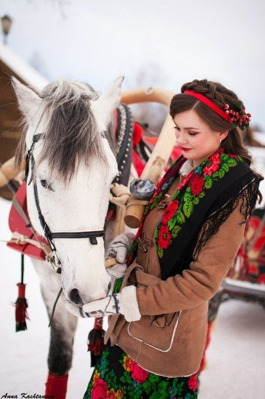 Russian beauty. Russian girls. Traditional Russian scarf. Horse. Winter