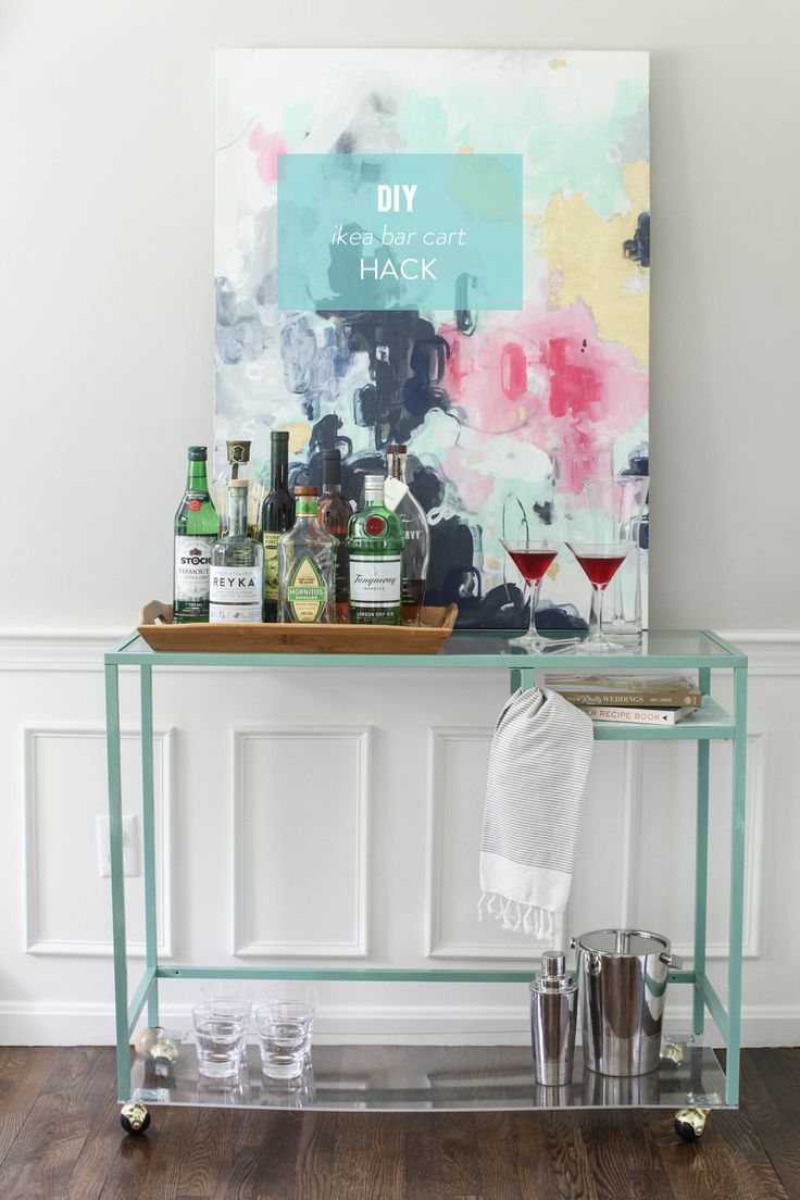 Kind of a fabulous Ikea DIY Hack... I'd use glass instead of plexiglass though to avoid warping | DIY Ikea Bar Cart Hack on stylemepretty