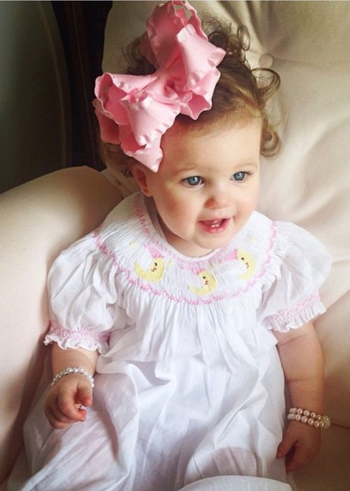 "Beautiful baby girls white bishop dress with little hand smocked I love you the the moon and stars, ξhand embroidered in pastel colors. Just one word must described this baby dress, ""Divine"". Fully li"