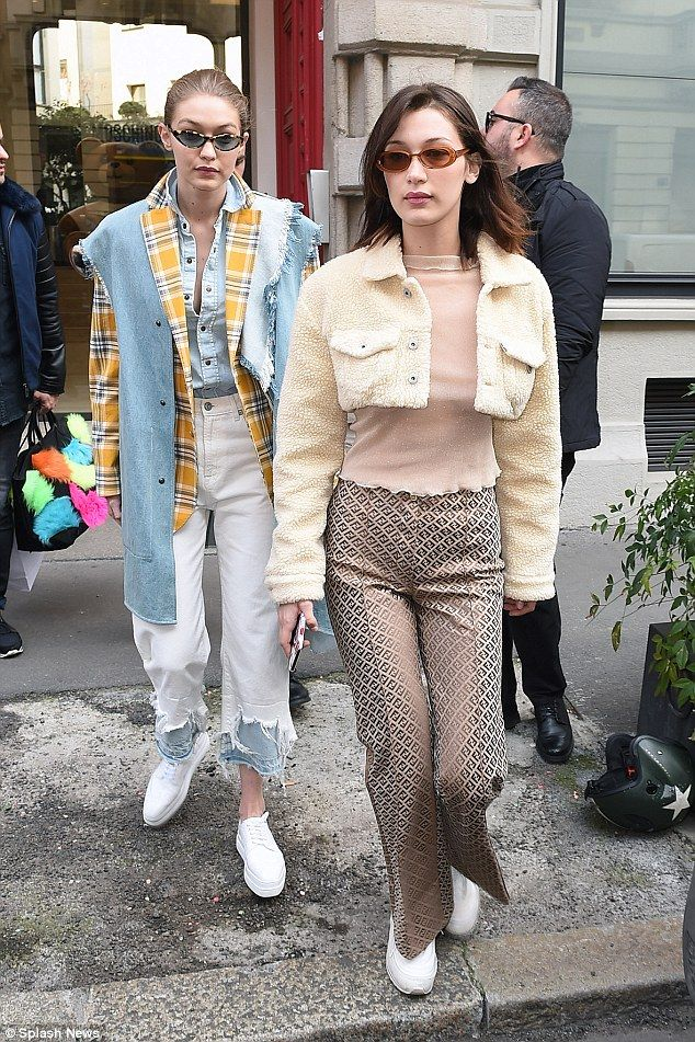 Double trouble: The pair were putting on a very fashionable display during their outing... #bellahadid