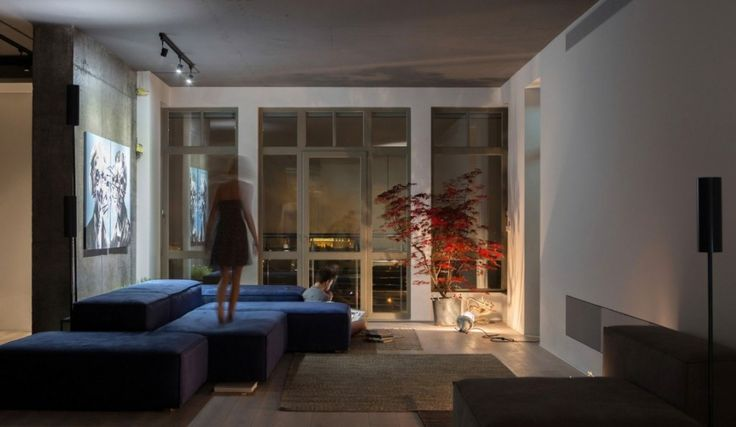 Loft: Cool Urban Loft in Kiev, Ukraine Designed by 2B Group, Lovely Urban Loft Living Room At Night with Dim Light Near from Red Plants