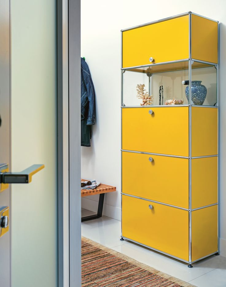 USM Haller glass showcase with four drop-down doors, USM golden yellow