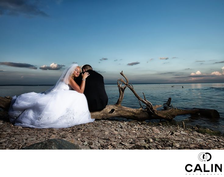 Photography by Calin - This image taken at Paletta Mansion in Burlington&nbsp,on the shore&nbsp,of Lake Ontario is me of the images that brides absolutely adore! The most interesting fact about this photo is that it was totally natural.&nbsp,    During the&nbsp,wedding photo shoot the groom took a seat on the fallen tree trunk. The bride just sat close to him and rested her head on the groom's shoulder. I asked my assistant to position the strobe light to&nbsp,camera right and I waited…