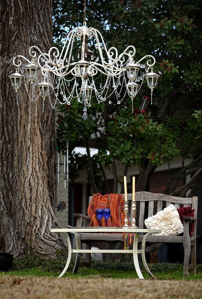 "Garden chandelier - Fort Worth, Texas!  Replaced lamps with solar. ""DIY Solar Light Candelier"" ... ~Sherry~  Find an old chandelier. Spray paint the color of your choice including the chain to hang it. Remove all the wiring. Add garden solar lights of your choice. How cute is this?"