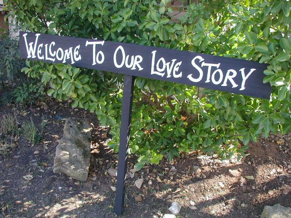 black white rustic wood wedding sign on stake welcome to our love story barn wood