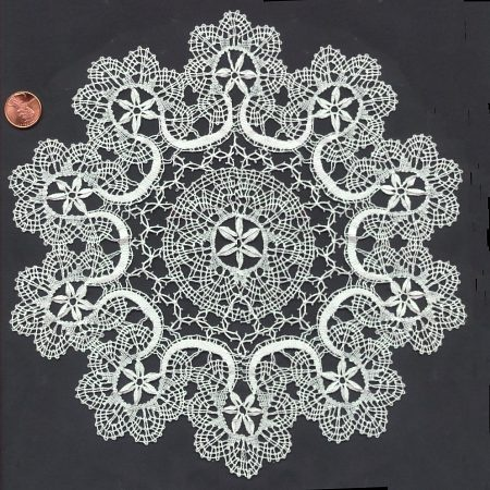 An advanced piece of Torchon lace. This is way, way beyond the beginner level that I achieved.