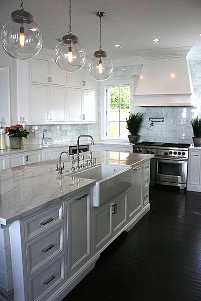 Kitchen. White cabinets, dark hardwood floors. Rustic lighting.