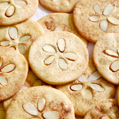 Sand dollar cookies; press slivered almond into shape on almond or butter cookie dough before baking; for beach theme party or wedding reception shower; by baking is hot blog; Upcycle, Recycle, Salvage, diy, thrift, flea, repurpose, refashion! For vintage ideas and goods shop at Estate ReSale & ReDesign, Bonita Springs, FL