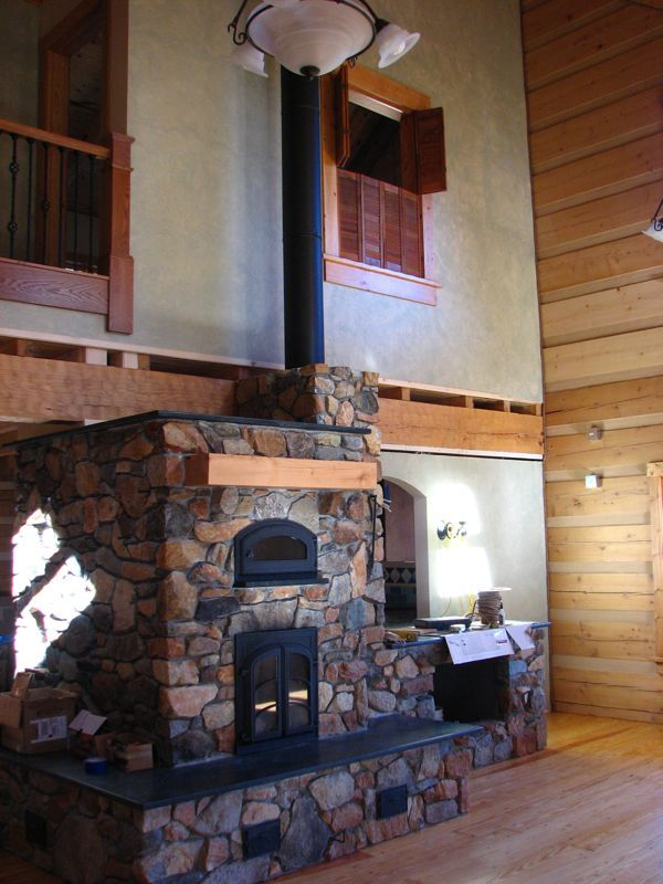 Another masonry heater but this time he has a 500 gallon hot water cistern sitting underneath it. Increased thermal mass and hot water for days. No, my Bride would just hate hot running water at the cabin. That would just suck.