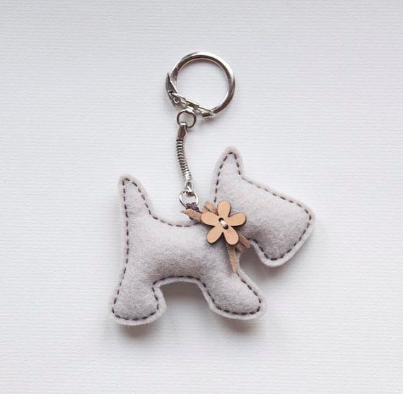 This cute little puppy with a wooden flower button is made of felt and stuffed with poly-fill, all pieces are hand-sewn.    It will arrive to you gift wrapped.    Puppy is app 8cm wide.