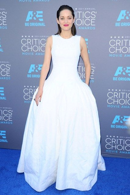 Marion Cotilard wore a Dior Couture gown with Chopard jewels.