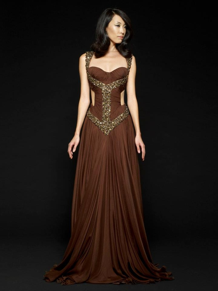Not usually a fan of brown at all...but this is beautiful. I adore the gold and bronze embellishments covering the torso in pattern form, and the cut-outs on the ribcage are ideal. Stunning gown. Love!
