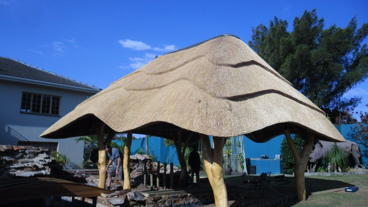 You can so creative with the shape and style of a thatched lapa - this one uses trees as the upright poles and has scalloped edges and thatching for a really rustic aesthetic