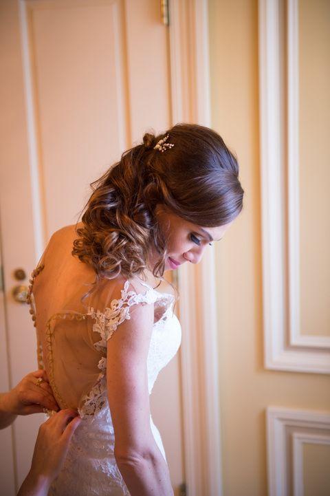 Vanita stepping into her stunning wedding gown before the ceremony! Vanita and Joe's wedding at Running Hare Vineyard in Prince Frederick, Maryland!