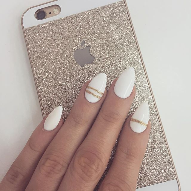 white and gold pointed oval nails