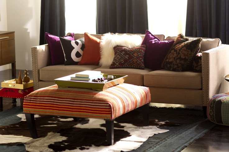 For an instant makeover, add a throw pillow (or three) to couches and chairs. Consider a variety of colors and patterns but make sure they are a similar size to bring together the eclectic collection. Freshening throw pillows is simple with the Upholstery Brush for the light weight Shark Lift-Around Portable Vac.