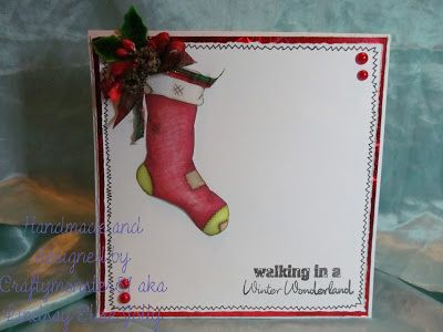 For this week I have had a another go at clean and simple with the new Stocking Digi fromLEJ Designscoloured with promarkers and then just stamped a sentiment from papermania, drew in a little border with a fine liner, layered on to holographic card and then added a little pine cone embellishment ribbon and pearls.