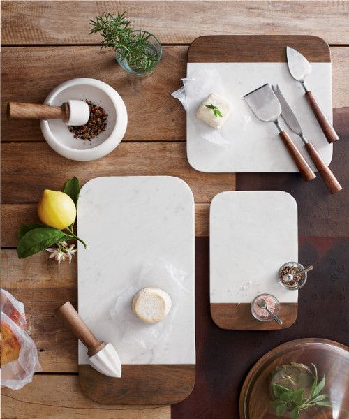 Elegant rounded corners and beveled edges distinguish this collection of modern white marble and sheesham wood table accessories.