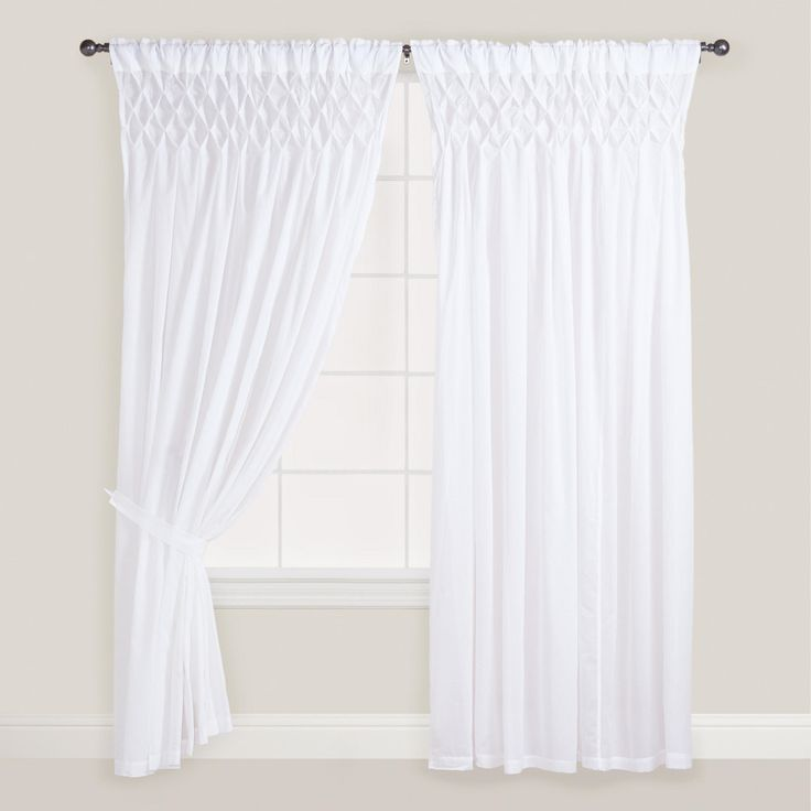 Maybe to cover the closet. Could be dressed up with a pattern on the bottom. White Smocked Top Curtain | World Market
