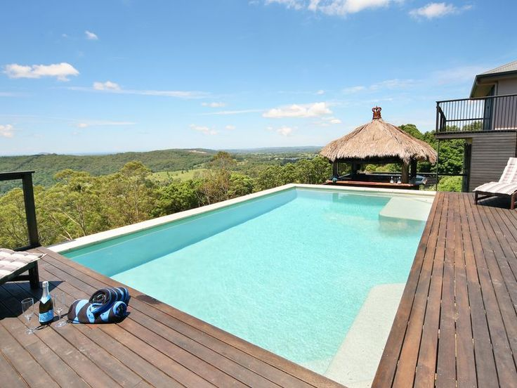 Outdoor suspended pool surrounded by deck + that view! | Tru-Built Builders Queensland
