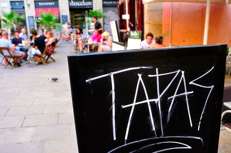 BARCELONA, SPAIN - AUGUST 16: A blackboard with word tapas in a restaurant terrace in Born district on August 16, 2011 in Barcelona, Spain. This district houses a large number of bars and restaurants.