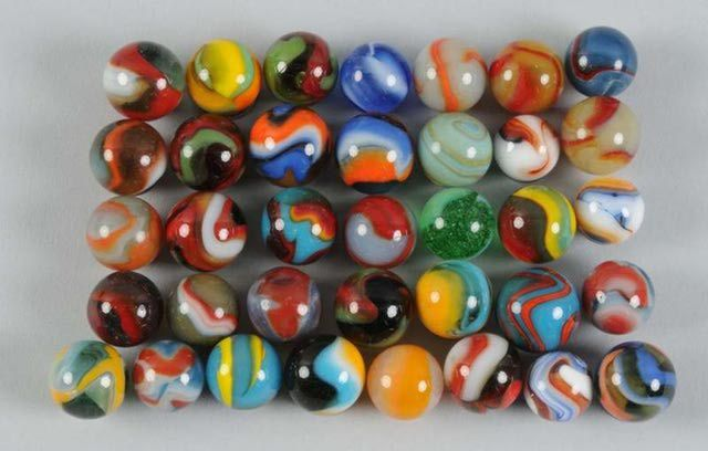 Marble Pictures and Prices: Assortment of Oxblood Marbles