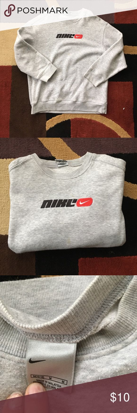 Child Nike crew neck! 🎉 Nike crew neck. General size could fit a petite woman, but the arms of the sweatshirt are short. Trendy. Two small stains that you can see in last pic, but good condition otherwise Nike Tops Sweatshirts & Hoodies
