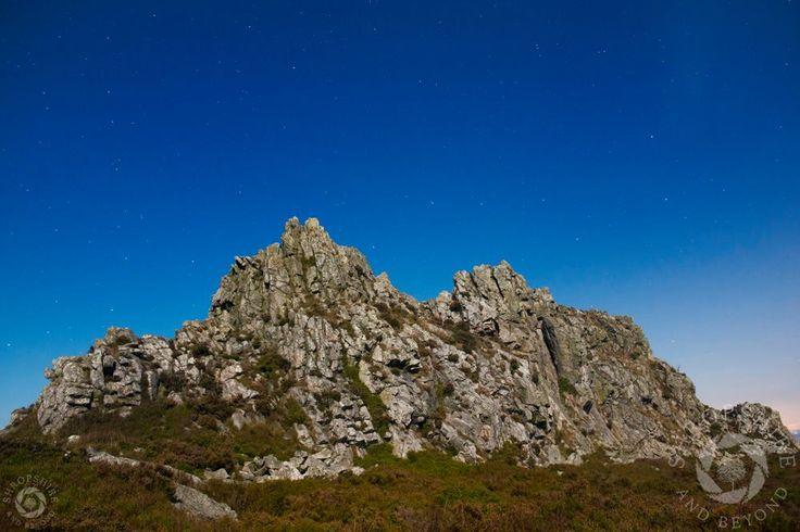 The Devil's Chair on the Stiperstones, Shropshire, illuminated by moonlight.