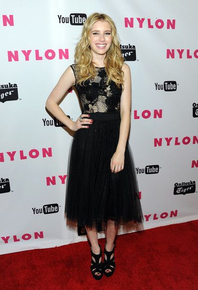Emma Roberts in Elie Saab tulle-and-lace dress with floral applique embellishment.