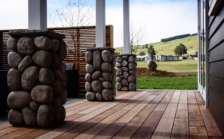 Beautiful stonework compliments the decking and exterior weatherboard.