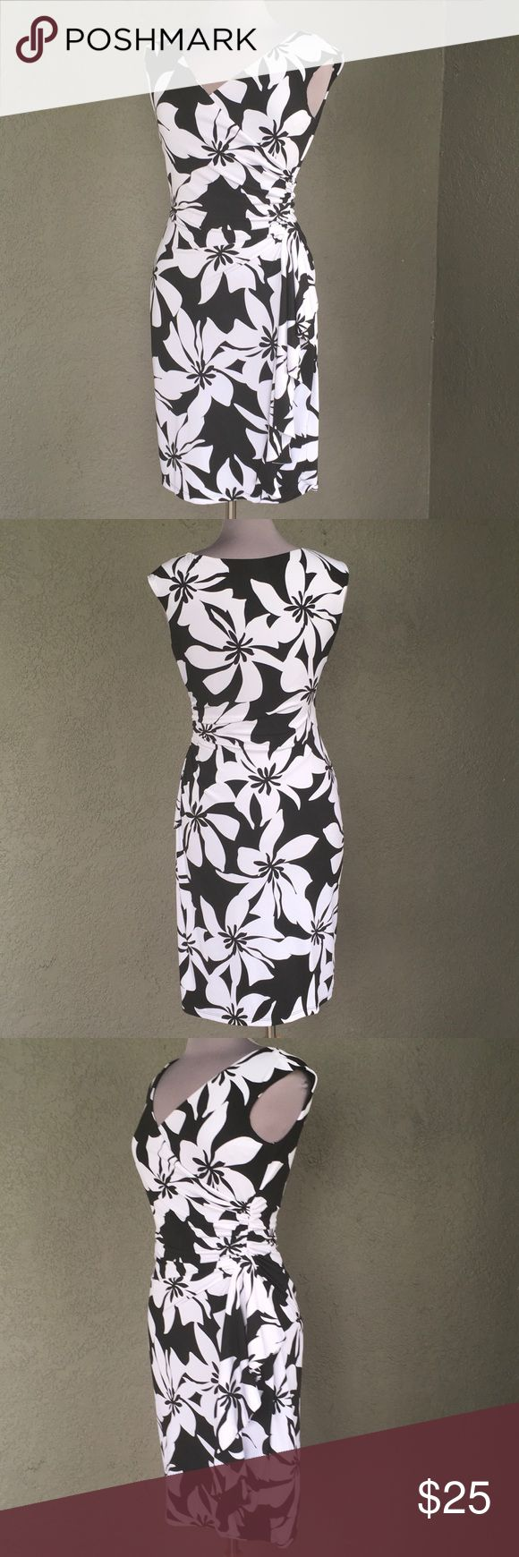 "Stunning flattering Black & White Dress Size 6 Gorgeous easy slip over head dress by White House / Black Market is sexy and designed to flatter!! Easy to travel, no wrinkle fabric is machine washable and ready to wear out of the dryer! Timeless floral tropical like print in black and white. Laying flat (not stretched) armpit to armpit = 18"" and dress back neckline at nape to hem = 38"" White House Black Market Dresses"