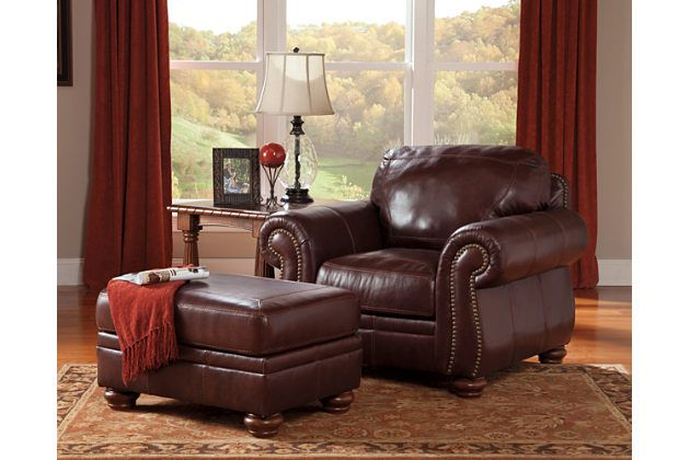 Big reddish brown leather chair with an ottoman footrest to add to your living room décor