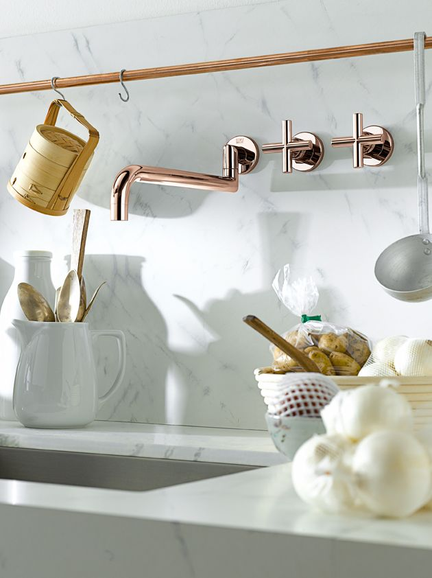 Nice tapware and copper rod for hanging pots and pans. Also like the seamless cut in sink.