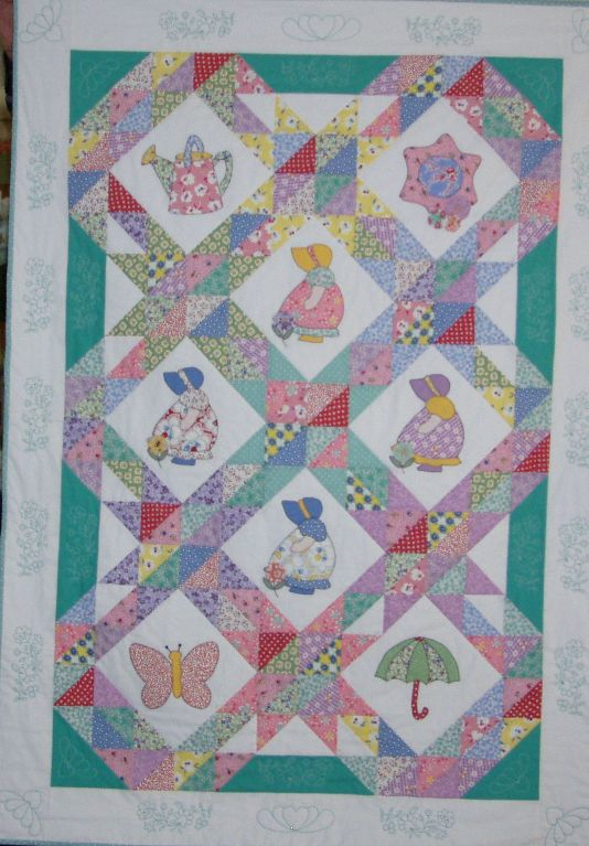 Sunbonnet Sue quilt shows many types of designs and materials mixed into the Sunbonnet Sue motif.