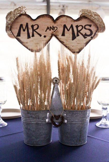country wedding idea--- hmm maybe we could do the small buckets oat stems and sunflowers???!!!!!!