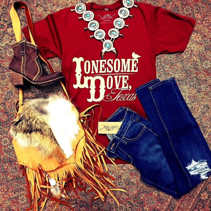 wildbleu The Clara | paprika v neck #lonesomedove tee $28 The McCalls | handcrafted high heel booties $275 The Melia | handmade by #wildbleu Mama, velvet doe hide cross body w/ coyote fur & antler charm $375 The Montgomeries | distressed skinnies $50 The Carlsbad | vintage squash blossom $3200