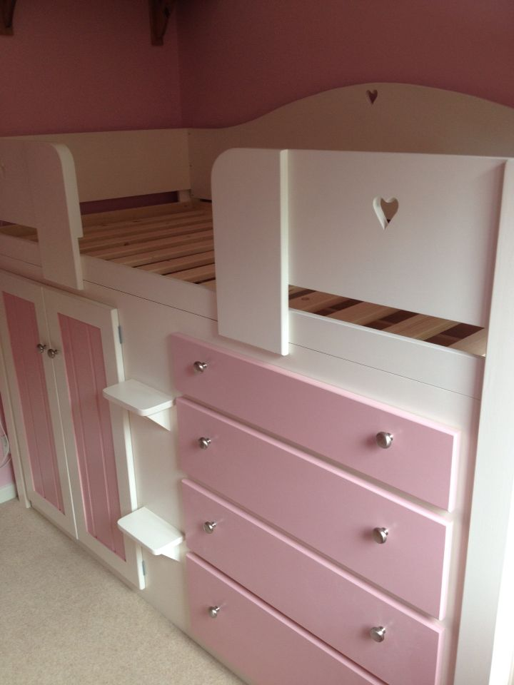 Childrens four drawer cabin bed in white and princess pink with heart cut outs for a more girly look. Guaranteed for 20 years and made to order. Only manufactured by Aspenn Furniture - a Yorkshire based company. No MDF is used in the furniture, only natural pine and solid oak.  Check out www.aspennfurniture.co.uk to see more of the children cabin bed range. 01937 843386 or email ianaspenn@btinternet.com