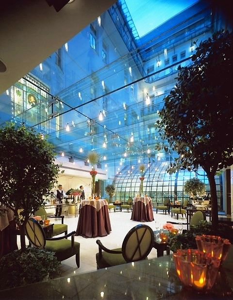 """Télikert"" at Four Seasons Hotel Gresham Palace Budapest has an incredible glass-enclosed space, an elegant way to spend the evening simultaneously inside, yet outside."