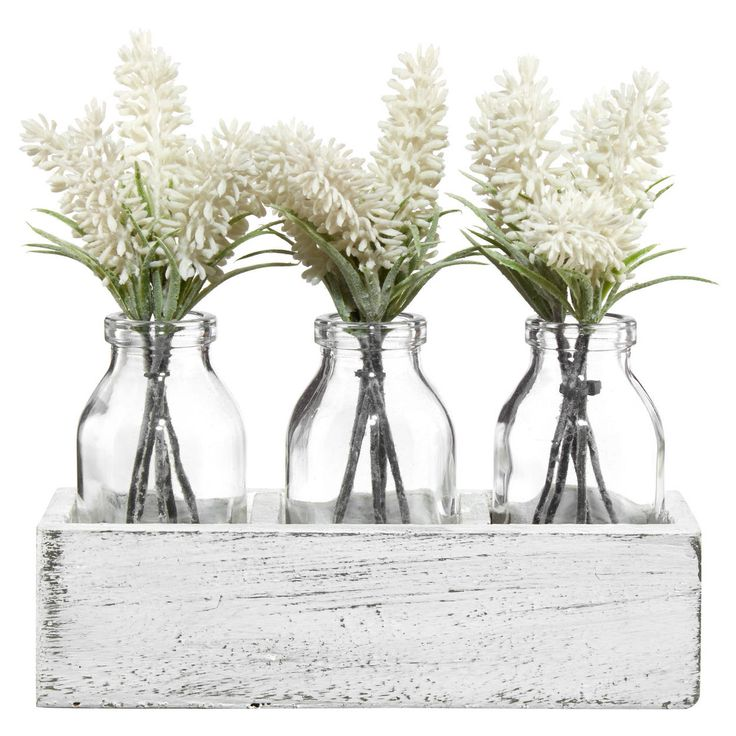 Inject a fresh touch of nature into your home with these pretty bunches of lavendar in a trio of jars. Sure to brighten up any room, this greenery is a great way to add life to your space without all the work of keeping a real plant alive! Perfect for green thumbs and black thumbs, alike, this faux flora would look great on a nightstand, end table, mantle or console table as part of a stylish vignette or on its own.