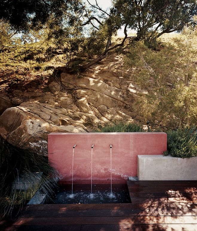 Eric Garcetti, mayor-elect of Los Angeles, and his partner, Amy Wakeland, transformed a mid-century house on a cozy hillside plot into a sustainable home with garden terraces and panoramic views. In their newly terraced yard, an outdoor water feature adds a subtle soundtrack to the property while keeping the plants irrigated. Photo by Misha Gravenor.