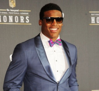 Cam Newton of the Carolina Panthers signed a four-year deal worth over $22 million that is fully guaranteed. A month later on September 1, 2011, he was named the Panthers' starting quarterback. In his NFL debut game on September 11, 2011, Newton was 24–37 passing for 422 yards, 2 touchdowns. He was the 2011 Rookie of the year and earned a trip to the Pro Bowl