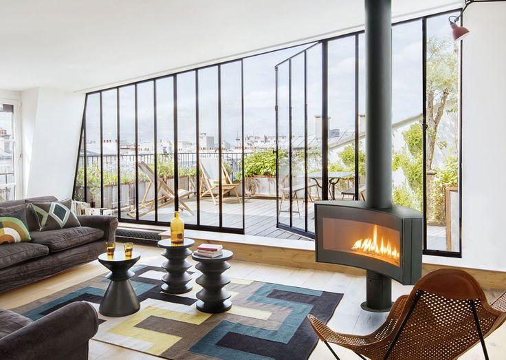 Poele design à gaz Curvifocus #Focus #cheminee #design #paris #salon #poele #acier #feu #centrale