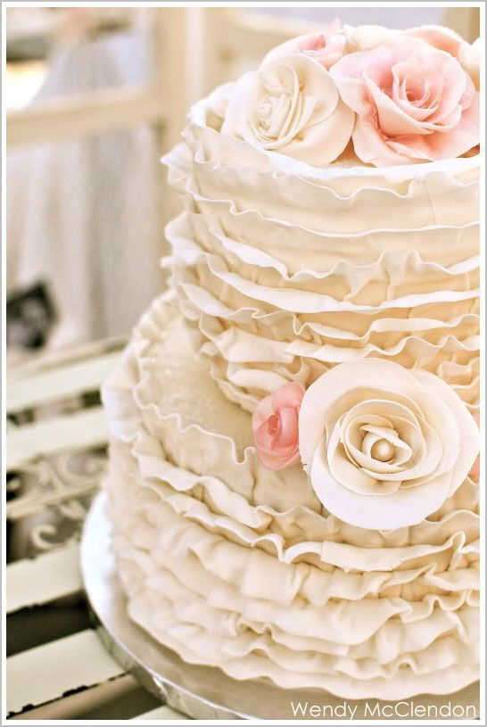 Ombre & Ruffle Wedding Cake Wonders - Cream Ruffle Wedding Cake with Roses. Layers upon layers of delicious ruffles!