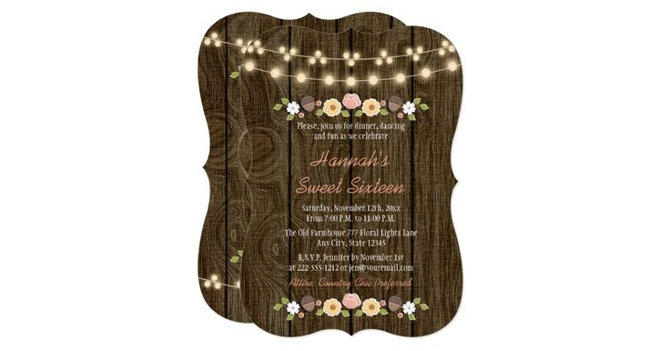 A floral rustic string of lights sweet sixteen invitation in blush, coral, green, brown, white, yellow and brown hues with a beautiful wood look background reminiscent of a wooden fence and or barrel. An autumnal laurel wreath composed of acorns, berries, sunflowers, tulip rose and white blossoms sit on a leafy branch. The back of the invite can be customized with the age of the birthday girl inside the carved tree look heart design. Perfect for an outdoor fall, night time, country…