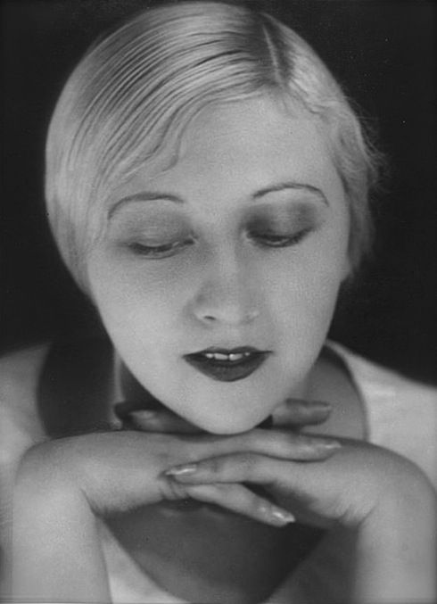 Woman with chin on her hands, ca. 1930's. Photo by Yva/Else Neuländer.